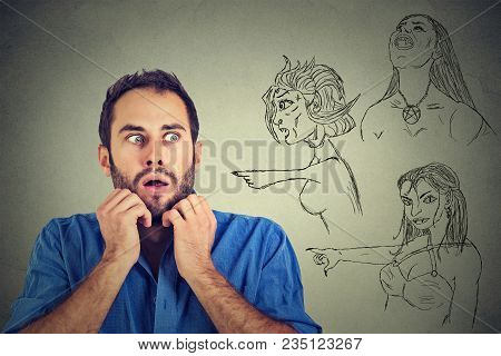 Bad Evil Women Pointing At Stressed Anxious Young Man. Negative Human Emotions Face Expression Feeli
