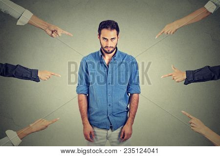 Concept Of Accusation Guilty Person Guy. Sad Depressed Upset Man Looking Down Many Fingers Pointing