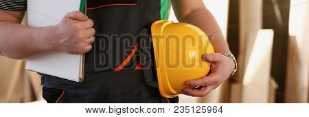 Handyman With Hands On Waist And Tool Belt With Construction Tools Against Wood Background. Diy Tool