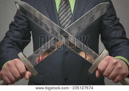 Businessman Holds In Hand A Crossed Toy Sword Weapon. Life Or Finance Insurance Agent. Money Deposit
