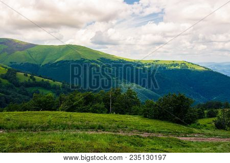 Beautiful Green Hills Of Borzhava Mountain Ridge. Lovely Landscape On A Cloudy Day. Foot Path Across