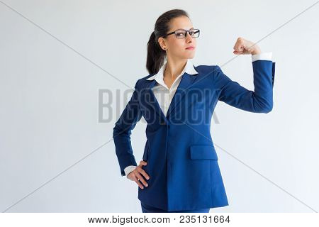 Content Confident Beautiful Businesswoman Showing Bicep. Serious Successful Young Caucasian Lady Pul