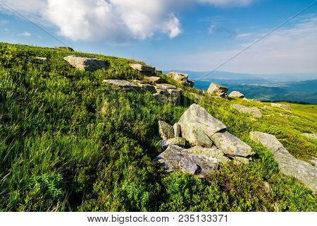 Grassy Hill With Lots Of Boulders. Lovely Mountainous Landscape. Fine Summer Weather