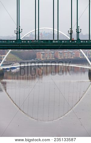Section Of The Tyne Bridge In The Foreground And Millenium Bridge In The Distance At Newcastle Quays