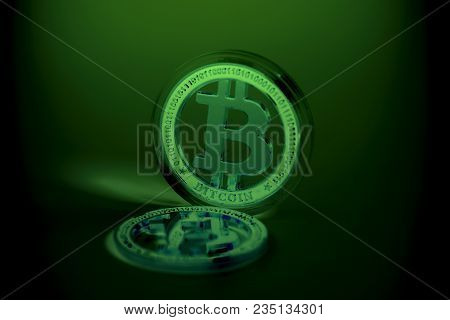 Golden Bitcoin Crypto Currency  On A Black Background.