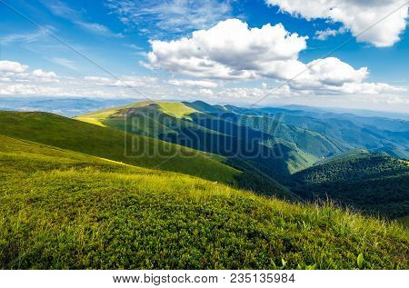Fluffy Clouds Over The Mountain Ridge. Gorgeous Summer Landscape Of Carpathian Alps. Fresh And Green