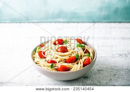 Italian Cuisine. Pasta With Olive Oil, Garlic, Basil And Tomatoes. Spaghetti With Tomatoes