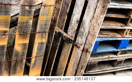 Decomposing Wooden Box And Stacked Pallets With Paint And Aged Distress