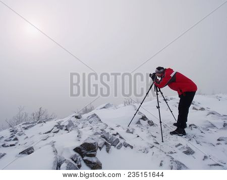 Silhouette Of Photographer With Tripod In The Fog.. Photographer Works In Foggy Winter Landscape