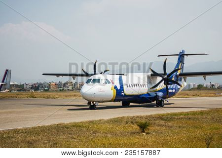 KATHMANDU, NEPAL - CIRCA MARCH 2108: A Buddha Air ATR 42 taxiing at Tribhuvan International Airport.