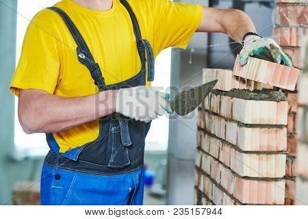 bricklayer builder worker laying bricks wall poster
