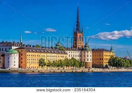 Panoramic View Across Lake Malaren Onto Traditional Gothic Buildings In The Old Town, Gamla Stan In