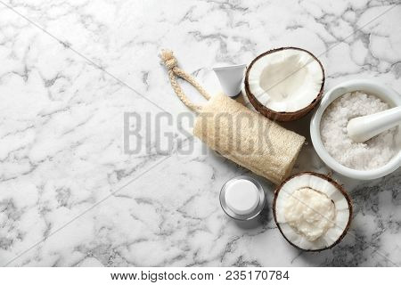 Composition With Handmade Natural Body Scrub In Nut On Light Background