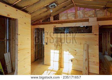 Woodgrain Paneling With Pillar And Ceiling Beam Moulding Construction Of A New Wooden House Of Woode
