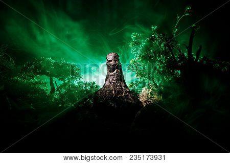 Female Demon. Demons Coming. Slhouette Of Devil Or Monster Figure On A Background Of Fire. Horror Vi