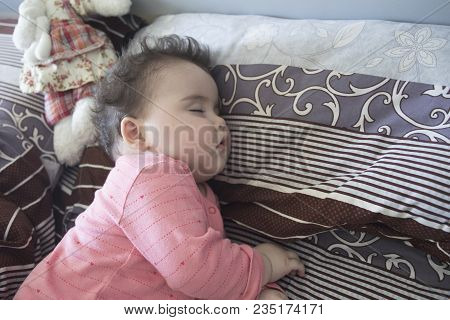 Sleeping Baby In Bed, 7 Month Old Baby Sleeping On Bed At Day Time.