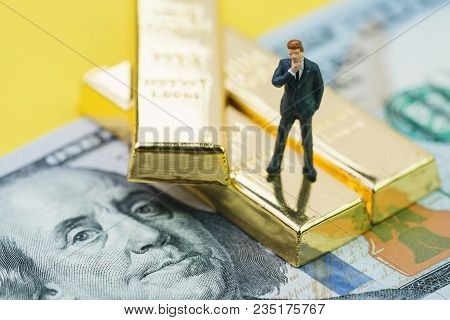 Wealth Management Or Success In Investment Concept, Miniature People Businessman Standing On Gold Bu