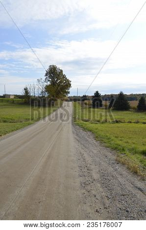 Unimproved Natural Beauty Road In The Rural Farmland And Countryside