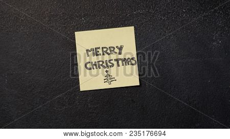 Merry Christmas note on the blackboard