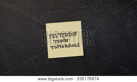 Note with Yesterday, Today and Tomorrow words on the blackboard