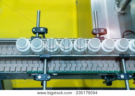 pharmaceutical packing production line conveyer at manufacture pharmacy factory.