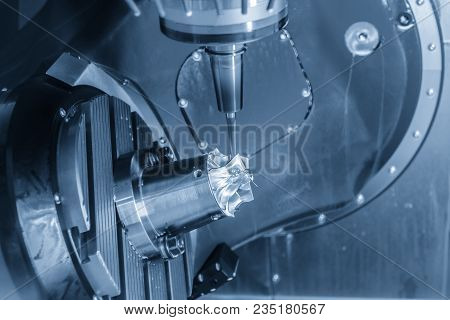 The Table Tile Type 5-axis Cnc Milling Machine Cutting The Aluminium Turbine Part In The Light Blue