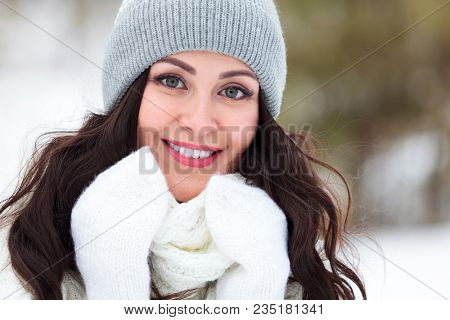 Pretty girl posing in winter forest