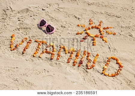 Sunglasses, Inscription Vitamin D And Shape Of Sun On Sand At Beach, Concept Of Vacation Time And Pr