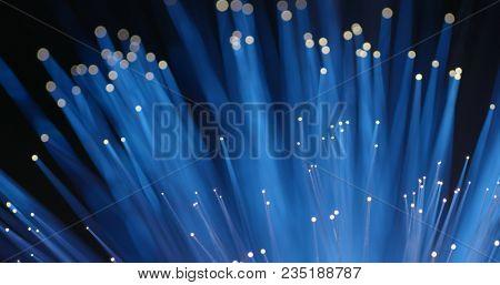 Glowing Fiber optics strands light in blue color