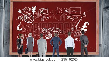 Rear view of business people looking at various symbols on red bulletin board
