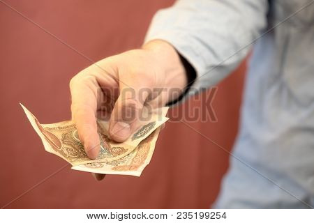 A Hand Stretched Out Into A Card Giving Money To The Beholder, Money Zancs Of The Old Times Deduced