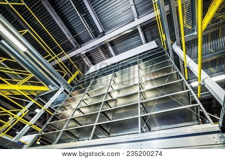 Large Warehouse Metal Shelving. Empty Shelves. Industrial Background