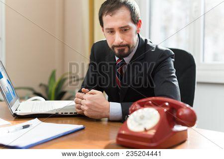Anxious businessman waiting for a phone call