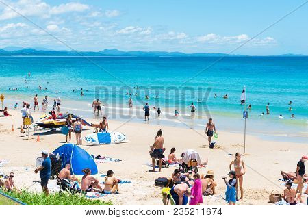 People Enjoying The Sunny Weather On The Beach At Byron Bay, Nsw, Australia