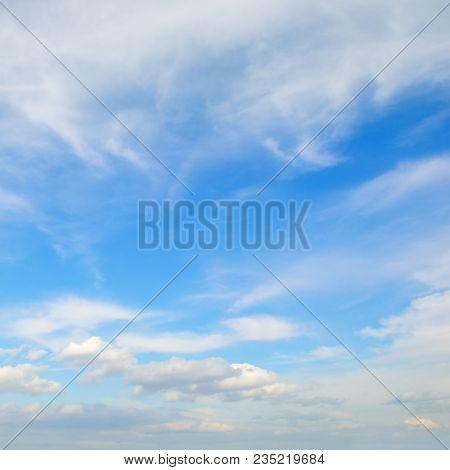 Light cumulus clouds in the blue sky poster