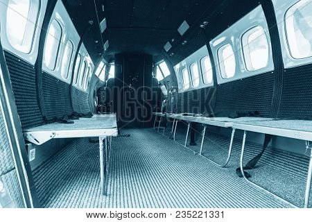 Interior Of Transport Aircraft For Parachute Jump, View To The Cabin With Seats For People. Plane Tr