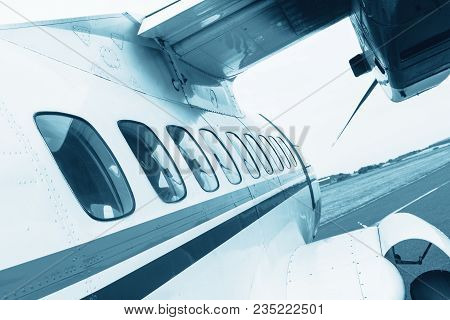 Turbolet Transport Aircraft For Parachute Jump, View Of The Airplane Windows
