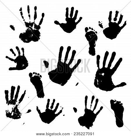 Black Prints Of Hands And Feet. Traces Of An Adult And A Child.