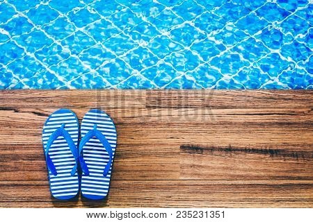 Top View Of Flip-flops On The Swimming Pool