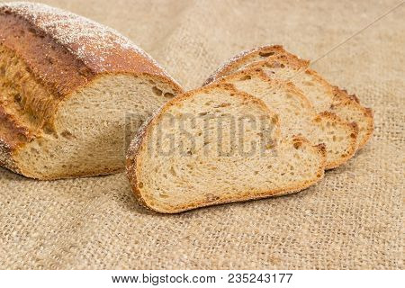 Partly Sliced Wheat And Rye Sprouted Bread With Added Whole Sprouted Wheat Grains, Rye Malt And Mola