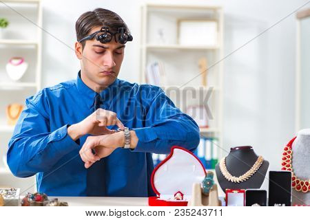 Jeweler working with luxury jewelry in the workshop