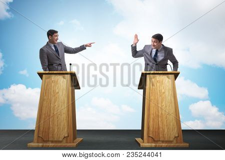 Two businessmen having heated discussion at panel discussion