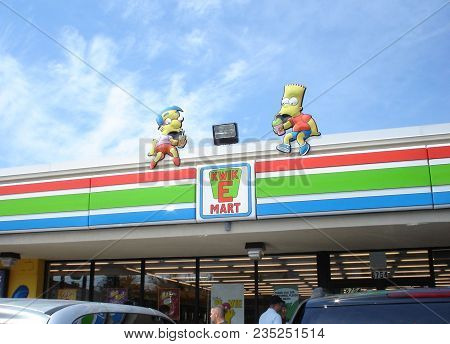 Bart Simpson And Milhouse Characters Above The Entrance To A Seven Eleven Turned Into A Kwik E Mart