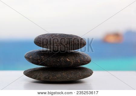 Rock stack on tropical beach. Zen, simplicity, spirituality and balance concept. Zen. poster