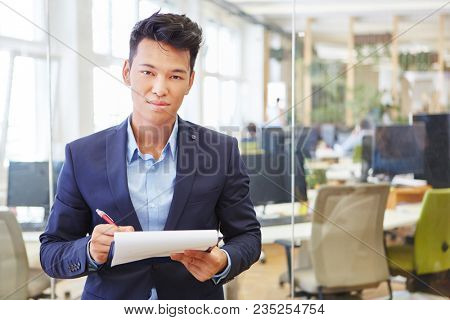Asian man as competent business expert and consultant with checklist
