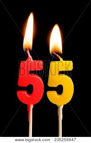 Burning Candles In The Form Of 55 Fifty Five (numbers, Dates) For Cake Isolated On Black Background.
