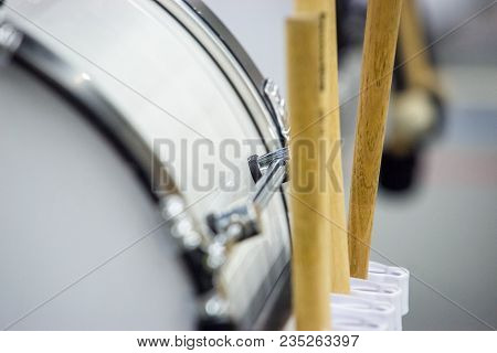 Several Drumsticks Mounted On A Bass Drum For Different Percussion Purposes. Supplies For Musicians