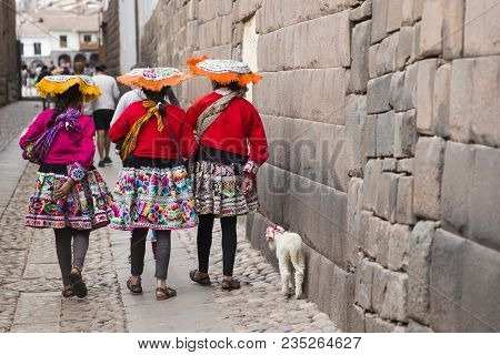 Cusco, Peru - January 1, 2018: Unidentified Women On The Street Of Cusco, Peru. The Entire City Of C