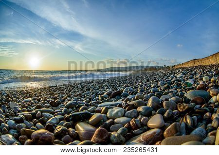 Surface And Sunny Summer Rocky Coastline With Clouds
