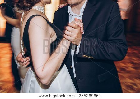 Happy Stylish People Dancing And Having Fun At Wedding Reception In Restaurant. Guests Dancing In Li